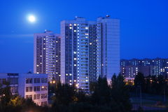 Arisen on the night of the full moon over the towers of the residential area in city Zelenograd. The full moon over the residential area of Zelenograd Stock Image