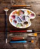 Aristic målarfärger och borstar Royaltyfria Bilder