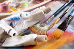 Aristic paint and brushes Royalty Free Stock Photography