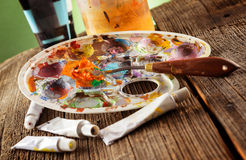 Aristic paint and putty knife Stock Photos