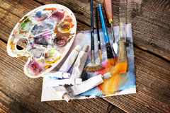 Aristic paints and brushes Royalty Free Stock Photography