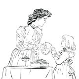 Aristocrat mother pouring her daughter a juice Royalty Free Stock Image