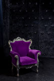 Aristocratic chair in classic interior. Luxurious antique interior in aristocratic style in dim light Stock Images