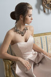 Aristocratic girl on old sofa Royalty Free Stock Photo