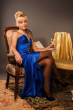 Aristocratic lady in a dark blue dress Stock Images