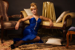 Aristocratic lady in a dark blue dress Stock Photos
