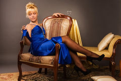 Aristocratic lady in a dark blue dress Royalty Free Stock Images