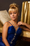 Aristocratic lady in a dark blue dress. In a luxurious boudoir Stock Photo