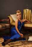 Aristocratic lady in a dark blue dress Stock Image