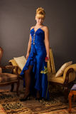 Aristocratic lady in a dark blue dress Royalty Free Stock Photography