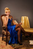 Aristocratic lady in a dark blue dress Stock Photography