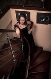 Aristocratic lady on stairs. In luxury house Royalty Free Stock Photo