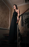 Aristocratic lady on stairs. In old house Stock Photography