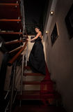 .aristocratic lady on stairs Royalty Free Stock Images
