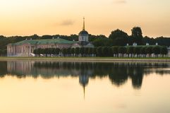 Aristocratic mansion and church with bell tower next to the pond in museum-estate Kuskovo, Moscow. Stock Images