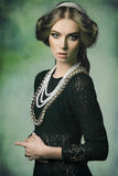 Aristocratic retro woman with jewellery Stock Photography