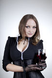 Aristocratic woman with glass of wine. Studio shot Stock Images