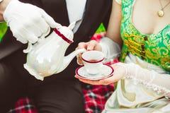 Aristocrats drink tea royalty free stock image