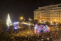 Aristotle`s square in Thessaloniki with the Christmas tree. Thessaloniki, Greece - November 30, 2017: Crowd of people in Aristotle`s square in Thessaloniki sees royalty free stock photo