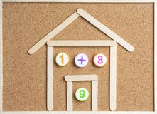 Free Arithmetic Toy Numbers On Cork Board. Royalty Free Stock Images - 125340019