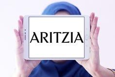 Aritzia fashion brand logo. Logo of Aritzia fashion brand on samsung tablet holded by arab muslim woman. Aritzia Inc. is a Canadian women fashion brand stock images