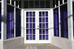 Arizona, Bisbee, USA, April 6, 2015, white doorway and purple drapes Stock Photos