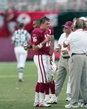 Arizona Cardinals QB Jake Plummer talking to coaches on Sideline. Image taken from color slide stock photography