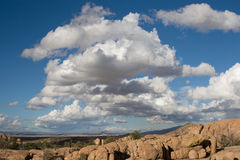 Arizona Chino Valley scenery. Arizona offers amazing blue skies, puffy clouds, and unique desert terrain. This is the Chino Valley in America stock image