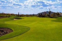 Arizona Desert Golf Course Fairway. Beautiful private Arizona desert golf course with various shades of green grass royalty free stock photography