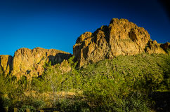 Arizona Desert. Superstition Mountains bathed in golden late afternoon light Stock Photo