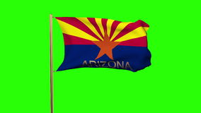 Arizona flag with title waving in the wind. Loops sun rises style stock video footage