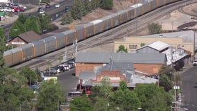Arizona, Flagstaff, A frieght train coming through Flagstaff, Arizona. A freight train coming through Flagstaff, Arizona from the east stock video