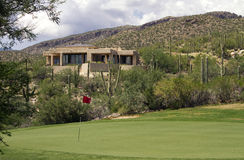 Arizona golf course scenic landscape and homes. Scenic desert landscape at Arizona golf course with luxury homes, cactus, native bushes, mountains and rocks stock image