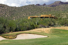 Arizona golf course scenic landscape and homes. Scenic desert landscape at Arizona golf course with luxury homes, cactus, native bushes, mountains and rocks royalty free stock photos