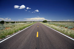 Arizona Highway. A highway stretches into the distance in the American Southwest Stock Photo