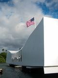 Arizona Memorial Pearl Harbor. An American flag flys over the Arizona Memorial where the USS Arizona was sunk during the attack on Pearl Harbor on Oahu Hawaii Royalty Free Stock Images