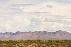 Arizona Monsoon Clouds Above Mountains. Thunderstorm clouds gathering above Arizona mountains in desert Royalty Free Stock Image