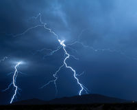 Arizona Monsoon Lightning 2012H. A pair of lightning bolts twisting through the air on their way down to a mountain near Arlington Arizona during the 2012 Royalty Free Stock Photos