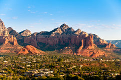 Arizona Red Rocks durind sunrise. Panoramic view of the city surrounded by the red stone mountains Royalty Free Stock Photo