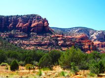 Arizona Red Rocks Of Sedona. Cliff face view of Sedona with trees in afternoon Royalty Free Stock Photography