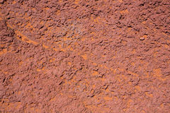 Arizona red stone detail with orange desert sand Stock Images