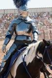 Arizona Renaissance Festival Jousting. Arizona Renaissance Festival 2017. Jouster in armor riding a jousting horse. Costumed characters, royalty, vendors, and Stock Image