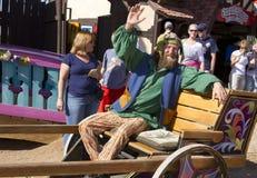 Arizona Renaissance Festival Man. A man rides in a human drawn cart at the  Arizona Renaissance Festival Stock Images