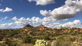 Arizona Scottsdale Desert landscape Pinnacle Peak Mountain. Arizona Scottsdale Desert landscape fluffy white clouds drift by Pinnacle Peak Mountain stock video