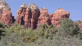 Arizona, Sedona, A close up of Coffeepot Rock with trees in the front of it