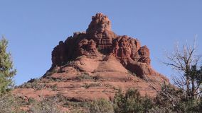 Arizona, Sedona, A view of Bell Rock framed by trees
