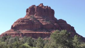 Arizona, Sedona, A view of Bell Rock with trees and desert landscape