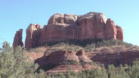 Arizona, Sedona, A view of Cathedral Rock surround by trees and bushes