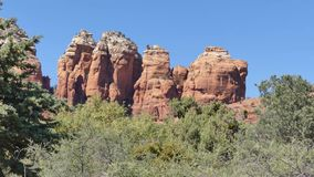 Arizona, Sedona, A zoom in on Coffeepot Rock with surrounding trees and bushes