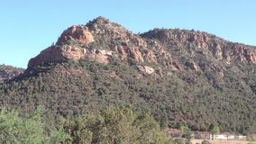Arizona, Sedona, A zoom in on a mountain and the surrounding desert landscape
